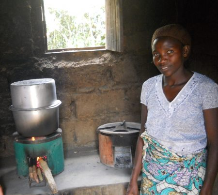 Rwandan woman with an improved cook stove